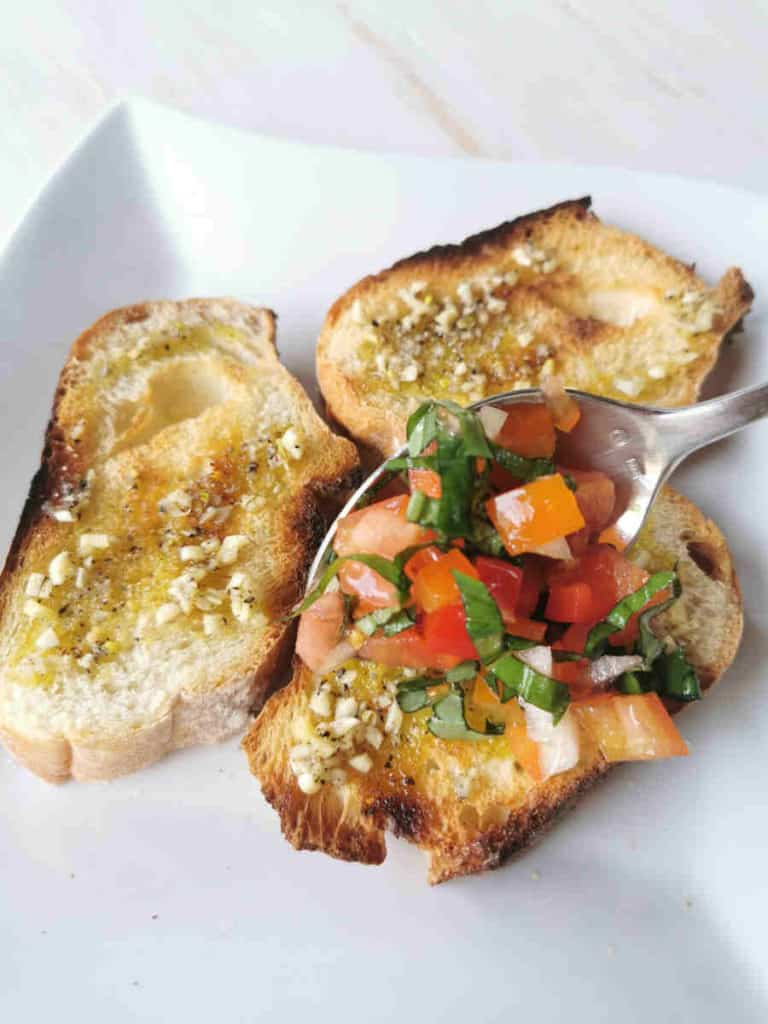 spoon bruschetta mixture onto bread