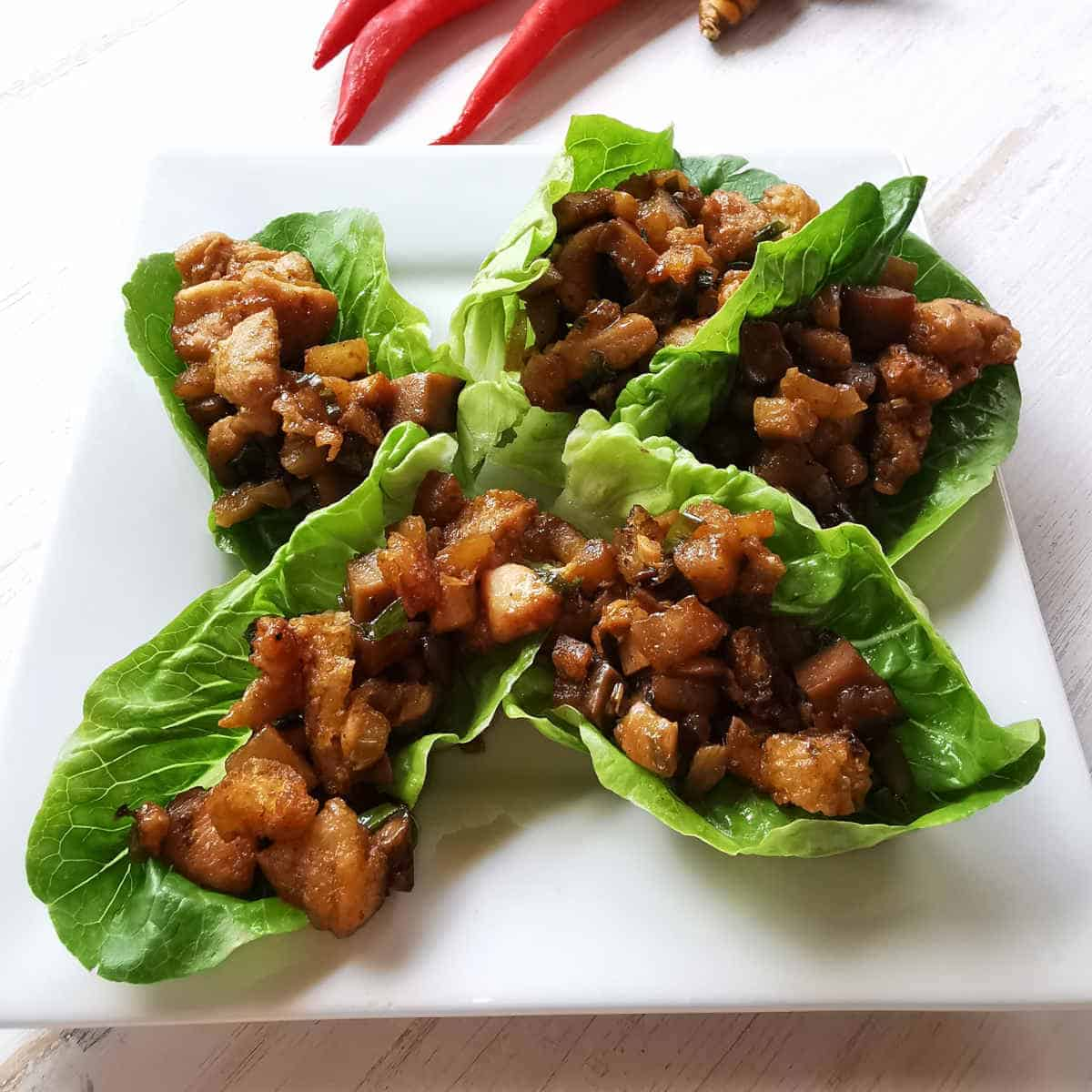 chicken san choy bow served on a plate