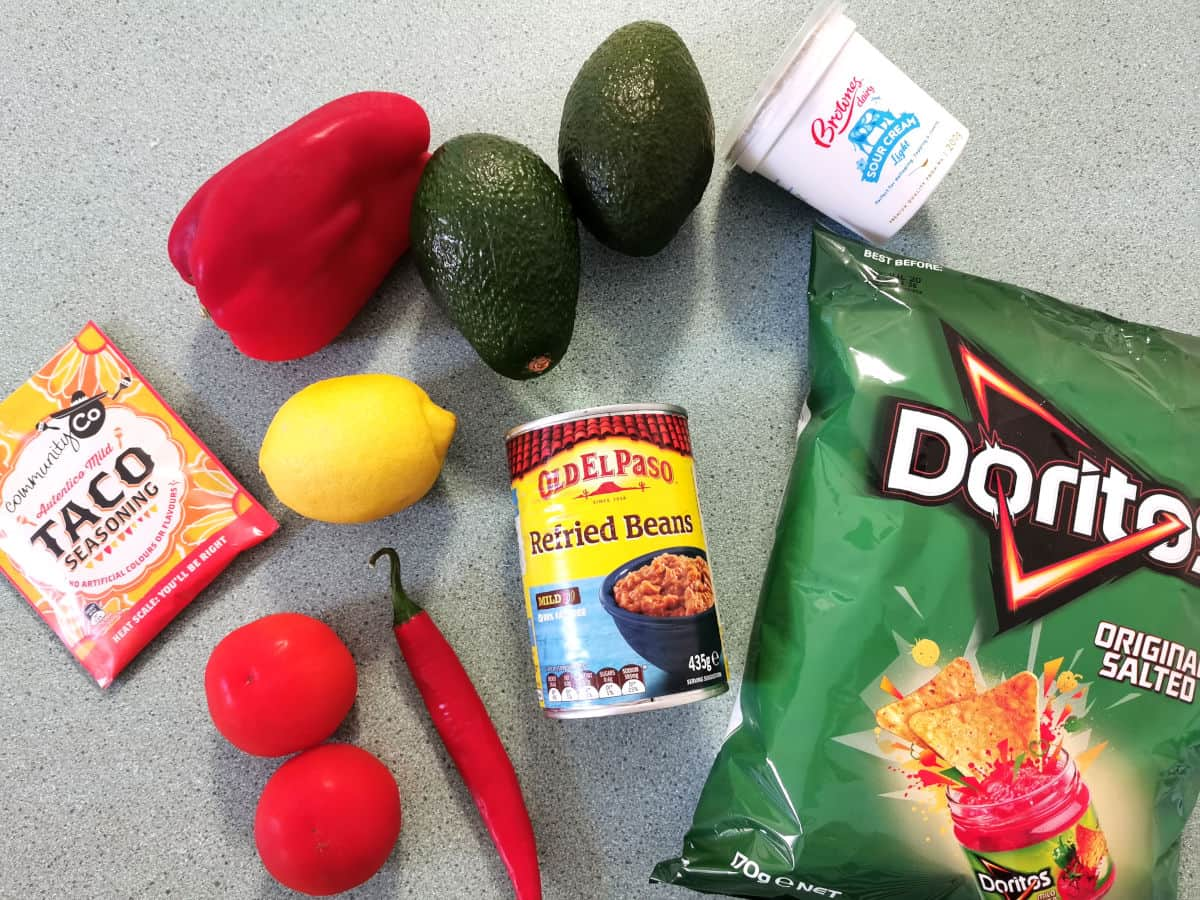 All the ingredients for Mexican sour cream dip on the counter ready to make