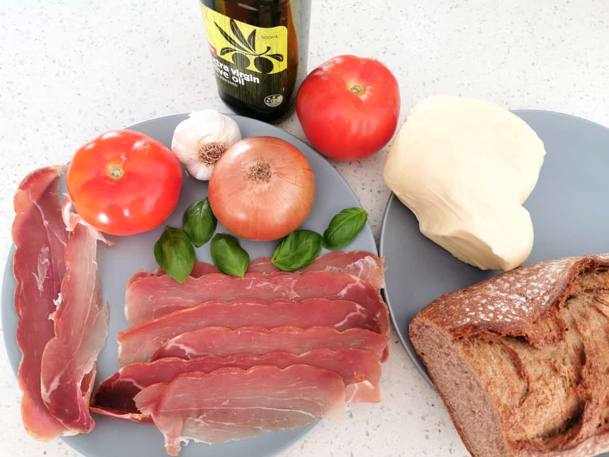 Ingredients for prosciutto bruschetta prepared and ready to cook