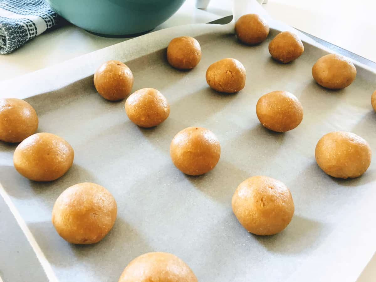 balls of cookie dough on a baking tray