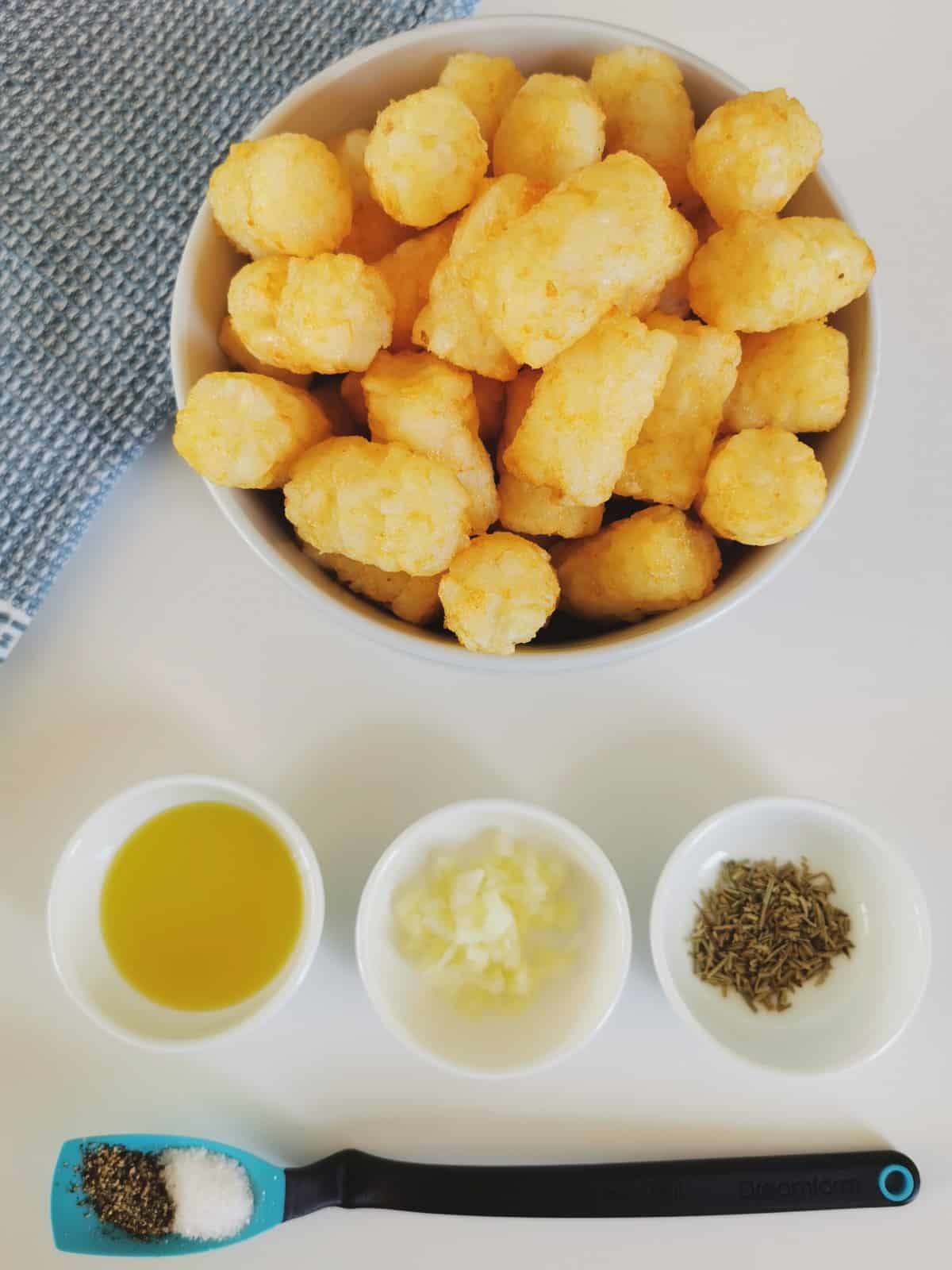the tater tots, spices and garlic are on the counter ready to make